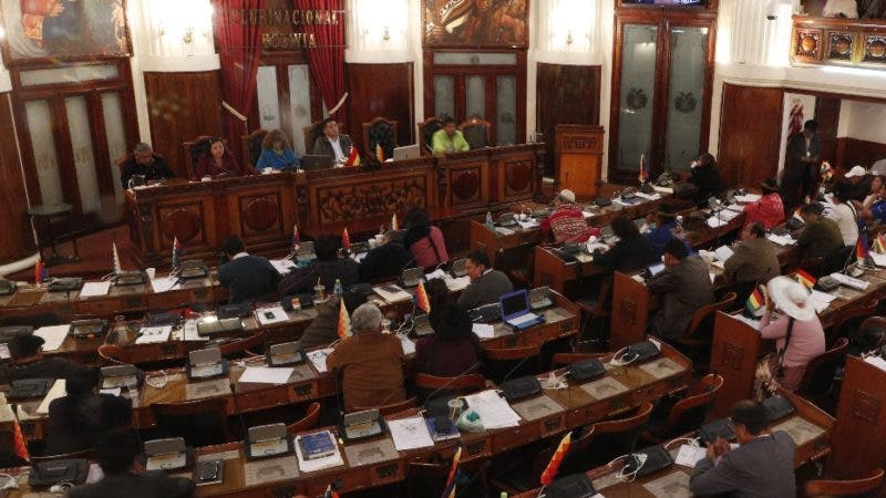 Lawmakers debate a law that would give amnesty to former President Evo Morales, at the Chamber of Deputies in La Paz, Bolivia, late Thursday, Dec. 5, 2019. The interim government of Bolivia warned that it will veto a legislative initiative that would grant an amnesty to Morales, currently exiled in Mexico, if approved by Congress where Morales' party MAS has majority. (AP Photo/Juan Karita)