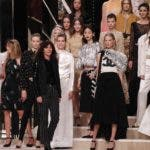 French fashion designer Virginie Viard, center, acknowledges applauses after the presentation of Chanel's Metiers d'Art collection at the Grand Palais in Paris, Wednesday, Dec.4, 2019. (AP Photo/Francois Mori)