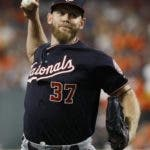 Washington Nationals starting pitcher Stephen Strasburg throws against the Houston Astros during the first inning of Game 2 of the baseball World Series Wednesday, Oct. 23, 2019, in Houston. (AP Photo/Matt Slocum)