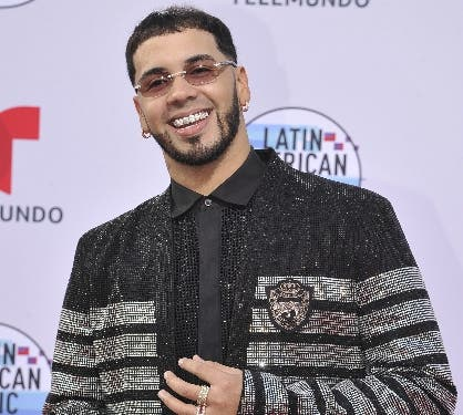 Anuel AA arrives at the Latin American Music Awards on Thursday, Oct. 17, 2019, at the Dolby Theatre in Los Angeles. (Photo by Richard Shotwell/Invision/AP)