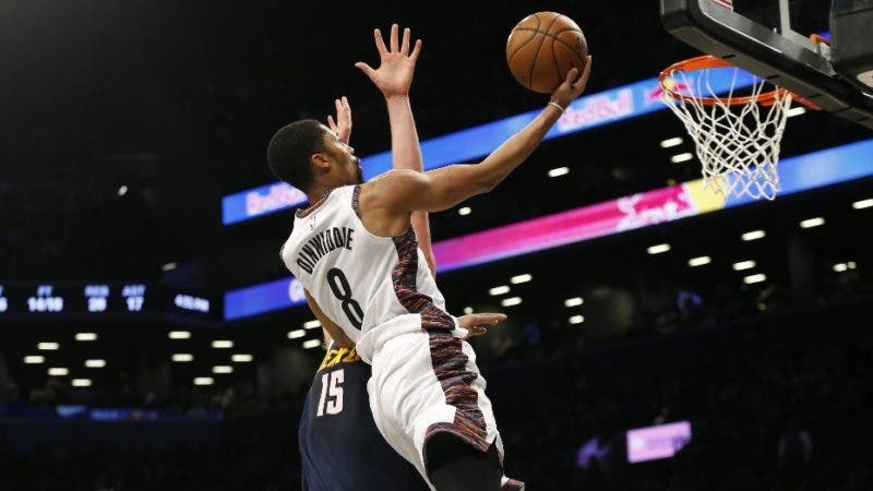 Brooklyn Nets guard Spencer Dinwiddie (8) puts up a shot against Denver Nuggets center Nikola Jokic (15) during the second half of an NBA basketball game on Sunday, Dec. 8, 2019, in New York. (AP Photo/Nicole Sweet)