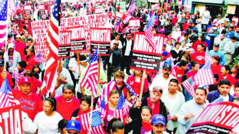 ** FOR STORY DECADA-HISPANOS  ** FILE - In this April 7, 2007 file photo, demonstrators calling for immigration reform march during an immigration protest rally in Los Angeles. Marchers filled the streets to demand amnesty for the nation's estimated 12 million illegal immigrants. (AP Photo/Stefano Paltera, File)