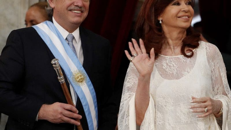 Argentina's President Alberto Fernandez, left, and Vice President Cristina Fernandez de Kirchner smile after they took the oath of office at the Congress in Buenos Aires, Argentina, Tuesday, Dec. 10, 2019. (AP Photo/Natacha Pisarenko)