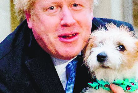 London (United Kingdom), 12/12/2019.- Britain's Prime Minster Boris Johnson leaves the polling station after casting his vote with his dog Dylan, during the general election in London, Britain, 12 December 2019. Britons go to the polls on 12 December 2019 in a general election to vote for a new parliament. (Elecciones, Reino Unido, Londres) EFE/EPA/VICKIE FLORES