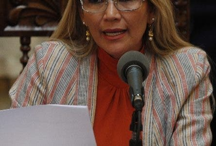Bolivia's interim President Jeanine Anez speaks during a press conference at the presidential palace, in La Paz, Bolivia, Thursday, Nov. 28, 2019. Anez reported today that she has determined to repeal Decree 4078, which authorized the military to participate in public restoration operations without having criminal responsibility for the use of force in situations of need and defense. (AP Photo/Juan Karita)