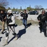 Members of the Mexican security forces spread out during a visit by Coahuila Gov. Miguel Riquelme, Villa Union, Mexico, Tuesday, Dec. 3, 2019. Mexican security forces fought an hour-long gun gun battle Saturday with suspected cartel gunmen in Villa Union, a town in Coahuila state about an hour's drive southwest of Eagle Pass, Texas, leaving at least 23 people dead. (AP Photo/Eduardo Verdugo)