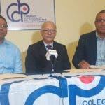 Carlos Arroyo, Perfecto Martínez y Juan Carlos Bisonó.