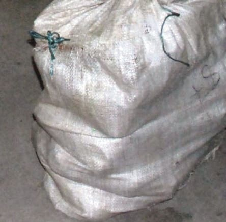 """A picture provided by Spanish National Police on January 5, 2016 shows packs of cocaine found in a van in Northwestern Spain. Spanish police announced on Januar 5, 2016 the seizure of three tons of Colombian cocaine in the northwest of Spain and the arrest of suspected traffickers of twelve, nationalities British, Dutch and Spanish..  They arrested eight people suspected of converting and selling the cars and seized 10 cars -- 17 fake Ferraris and two imitation Aston Martins.  RESTRICTED TO EDITORIAL USE - MANDATORY CREDIT """"AFP PHOTO/ HO/ SPANISH NATIONAL POLICE"""" NO MARKETING NO ADVERTISING CAMPAIGNS - DISTRIBUTED AS A SERVICE TO CLIENTS"""