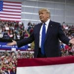 In this Jan. 14, 2020, photo, President Donald Trump arrives at UW-Milwaukee Panther Arena to speak at a campaign rally in Milwaukee. Trump's surrogates are fanning out across the country as part of an aggressive effort to stretch his appeal beyond the base of working-class white voters who propelled him to victory in 2016 (AP Photo/ Evan Vucci)