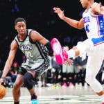 Philadelphia 76ers center Al Horford (42) guards Brooklyn Nets guard Caris LeVert (22) during the second half of an NBA basketball game, Monday, Jan. 20, 2020, in New York. The 76ers won 117-111. (AP Photo/Mary Altaffer)