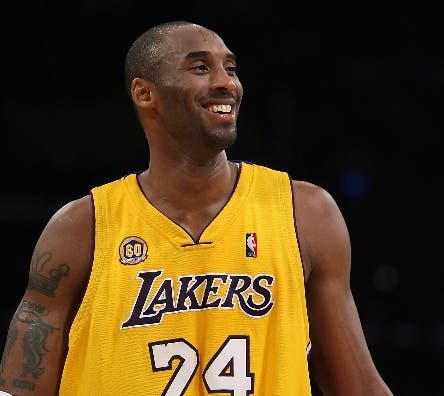 Kobe Bryant #24 of the Los Angeles Lakers smiles during the NBA game against the Toronto Raptors at Staples Center on March 11, 2008 in Los Angeles, California.        Christian Petersen/Getty Images/AFP    == FOR NEWSPAPERS, INTERNET, TELCOS & TELEVISION USE ONLY ==