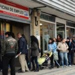 People wait in line at a government employment office at Santa Eugenia's Madrid suburb on January 27, 2012. Spain's unemployment rate shot to 22.85 percent in the final quarter of 2011, the highest in the industrialized world, as jobless numbers hit 5.27 million, official figures showed on January 27, 2012. AFP PHOTO / DOMINIQUE FAGET