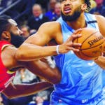 Minnesota Timberwolves center Karl-Anthony Towns, right, drives past Houston Rockets guard James Harden during the first half of an NBA basketball game Friday, Jan. 24, 2020, in Minneapolis. (AP Photo/Craig Lassig)