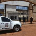 "Police mount guard at Pedro Juan Caballero city jail entrance in Paraguay, Sunday, Jan. 19, 2020. Dozens of inmates escaped from this prison early morning, mostly of Brazil's criminal group PCC, ""Capital First Command"". (AP Photo/Marciano Candia)"