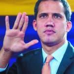 """AME2214. CARACAS (VENEZUELA), 15/01/2020.- El líder opositor venezolano Juan Guaidó dirige este miércoles una sesión parlamentaria en un auditorio ubicado en el sector El Hatillo, en el este de Caracas (Venezuela). Guaidó calificó los actos vividos este miércoles en los alrededores de la Asamblea Nacional (AN, Parlamento) como una """"toma"""" de la sede del Legislativo ejecutada por """"paramilitares"""", lo que considera que """"devela"""" la """"dictadura"""" del presidente Nicolás Maduro. EFE/ Miguel Gutiérrez"""