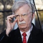 FILE - In this March 5, 2019 file photo, national security adviser John Bolton adjusts his glasses before an interview at the White House in Washington.  (AP Photo/Jacquelyn Martin)