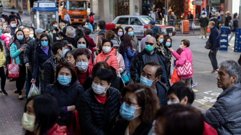 Pepole buy face masks as a precaution against coronavirus, in Hong Kong