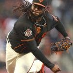 San Francisco Giants pitcher Johnny Cueto works against the Los Angeles Dodgers during the first inning of the second game of a baseball doubleheader Saturday, April 28, 2018, in San Francisco. (AP Photo/Ben Margot)