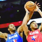 Kawhi Leonard of the Los Angeles Clippers blocks a shot of Giannis Antetokounmpo of the Milwaukee Bucks during the second half of the NBA All-Star basketball game Sunday, Feb. 16, 2020, in Chicago. (AP Photo/Nam Huh)