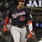 Washington Nationals' Juan Soto celebrates after a home run against the Los Angeles Dodgers during the eighth inning in Game 5 of baseball's National League Division Series on Wednesday, Oct. 9, 2019, in Los Angeles. (AP Photo/Marcio Jose Sanchez)a