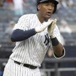 New York Yankees' Miguel Andujar reacts as he rounds the bases after hitting a two-run home run during the seventh inning of a baseball game against the Texas Rangers Saturday, Aug. 11, 2018, at Yankee Stadium in New York. (AP Photo/Bill Kostroun)