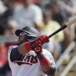 Minnesota Twins designated hitter Nelson Cruz (23) follows through on a two-run home run in the third inning of a spring training baseball game against the Boston Red Sox Monday, Feb. 24, 2020, in Fort Myers, Fla. (AP Photo/John Bazemore)