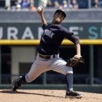 New York Yankees starting pitcher Deivi Garcia (83) works in the first inning of a spring training baseball game against the Atlanta Braves Friday, Feb. 28, 2020, in North Port, Fla. (AP Photo/John Bazemore)