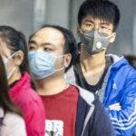 Guangzhou (China), 13/02/2020.- People queue outside a pharmacy as they won the lottery to buy protective masks, in Guangzhou, China, 13 February 2020. On 12 February Hubei province recorded the largest single-day spike in coronavirus-related deaths, with 242 victims and 14,840 people diagnosed with Covid-19. The disease caused by the SARS-CoV-2 has been officially named Covid-19 by the World Health Organization (WHO). The outbreak, which originated in the Chinese city of Wuhan, has so far killed at least 1,369 people with over 60,000 infected worldwide, mostly in China. EFE/EPA/ALEX PLAVEVSKI