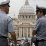 "FILE - In this Tuesday, Sept. 21, 2010 file photo Italian financial Police officers talk to each other in front of St. Peter's square at the Vatican. A Rome court has upheld the seizure of euro23 million ($31 million) from a Vatican bank account, and the Holy See is expressing ""astonishment"" over the decision. Vatican spokesman the Rev. Federico Lombardi says the Holy See ""learned of the ruling with astonishment."" Lombardi said Wednesday, Oct. 20, 2010 that Vatican bank officials maintain they can clarify the matter soon. The seizure last month was based on alleged violations of Italy's laws against money laundering. Lombardi indicated that the Vatican is contending the problem is a matter of how the regulations are interpreted. (AP Photo/Angelo Carconi/File)"