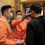 Macao (China), 19/02/2020.- Casino workers workers wearing protective masks check the temperature of a visitor to detect traces of Coronavirus infection, at a Casino in Macao, China, 20 February 2020. Twenty-nine casinos are to reopen starting 20 February, and 12 remain closed, the authorities of the gambling capital said, one of the regions that have identified cases of infection by the coronavirus Covid-19. After 15 days of closure, Macau's government said on 17 February that the casinos could reopen, giving operators 30 days to return to business. (Abierto, Macao) EFE/EPA/CARMO CORREIA