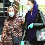 Tehran (Iran (islamic Republic Of)), 26/02/2020.- Iranian women wearing face masks walk on a street of Tehran, Iran, 26 February 2020. According to the Ministry of Health, 139 people diagnosed with the Covid-19 coronavirus and 19 people have died in Iran. (Teherán) EFE/EPA/ABEDIN TAHERKENAREH