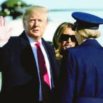 President Donald Trump, with first lady Melania Trump, wave as they walk to board Air Force One during departure, Sunday, Feb. 23, 2020, at Andrews Air Force Base, Md. Trump is traveling to India. (AP Photo/Alex Brandon)