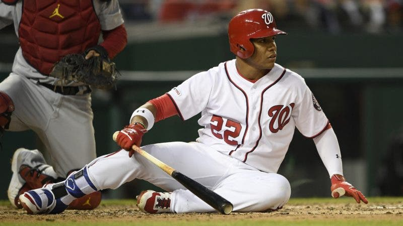 Washington Nationals' Juan Soto sits on the ground after a close pitch during the third inning of a baseball game against the St. Louis Cardinals, Monday, April 29, 2019, in Washington. (AP Photo/Nick Wass)
