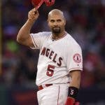 Los Angeles Angels' Albert Pujols tips his helmet to fans after hitting an RBI double during the third inning of a baseball game against the Seattle Mariners Saturday, April 20, 2019, in Anaheim, Calif. With that RBI, Pujols tied Babe Ruth for 5th place on the all-time RBI list with 1,992. (AP Photo/Mark J. Terrill)
