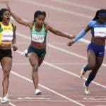 Elaine Thompson ofJamaica wins the gold medal in the women's 100m final during the athletics at the Pan American Games in Lima, Peru, Wednesday, Aug. 7, 2019. Vitoria Cristina Silva ofBrazil won the bronze medal. (AP Photo/Ricardo Mazalan)