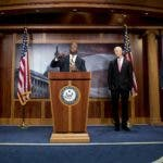 "Sen. Tim Scott, R-S.C., center, accompanied by Sen. Ben Sasse, R-Neb., left, Sen. Rick Scott, R-Fla., second from right, and Sen. Lindsey Graham, R-S.C., right, speaks at a news conference about the coronavirus relief bill on Capitol Hill in Washington, Wednesday, March 25, 2020. Senators discussed what they are calling a ""drafting error"" in the 2 trillion dollar stimulus bill. (AP Photo/Andrew Harnik)"
