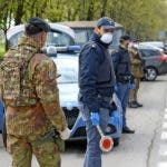 Bresso/cinisello Balsamo (Italy), 30/03/2020.- Italian soldiers and law enforcement officers conduct checks on drivers during the country's lockdown due to the novel coronavirus disease pandemic, at a check-point between Bresso and Cinisello Balsamo, near Milan, northern Italy, 30 March 2020. Some 168 individuals out of a total of 4,754 checks, were fined a day earlier on the basis of a recent decree issued by the Italian Government to face the coronavirus emergency, which provides administrative sanctions ranging from 400 to 3,000 euros for violations of the current containment measures. (Italia) EFE/EPA/SERGIO PONTORIERI