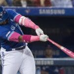 Toronto Blue Jays' Vladimir Guerrero Jr. hits a double against the Chicago White Sox during the first inning of a baseball game in Toronto, Sunday, May 12, 2019. (Fred Thornhill/The Canadian Press via AP)