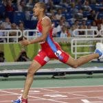 Felix Sanchez, of the Domincan Republic, reacts as he crosses the finish line ahead to win the gold medal  in the 400-meter hurdles finals at  the Olympic Stadium during the 2004 Olympic Games in Athens, Thursday Aug. 26, 2004. Keita won the bronze. (AP Photo/Thomas Kienzle)