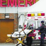 New York (United States), 08/04/2020.- Paramedics transport a patient to the Emergency room at Kingsbrook Jewish Medical Center, in Brooklyn, New York, USA, 08 April 2020. New York City is still the epicenter of the coronavirus outbreak in the United States and the city is still trying to get people to either stay at home or maintain a safe distance from each other. (Estados Unidos, Nueva York) EFE/EPA/Peter Foley