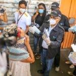 Autoridades de Salud Publica,  durante operativo de intervención del Gran Santo Domingo. Hoy/Arismendy Lora
