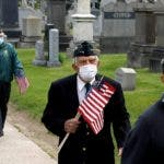 New York (United States), 24/05/2020.- Members of the 69th New York Regiment, former US servicemen march to place flags and pay tribute to their comrades at Calvary Cemetery in Queens, New York, USA, 24 May 2020. The United States will observe Memorial Day on Monday to honor military personnel who died while serving in the US Armed Forces. (Estados Unidos, Nueva York) EFE/EPA/Peter Foley