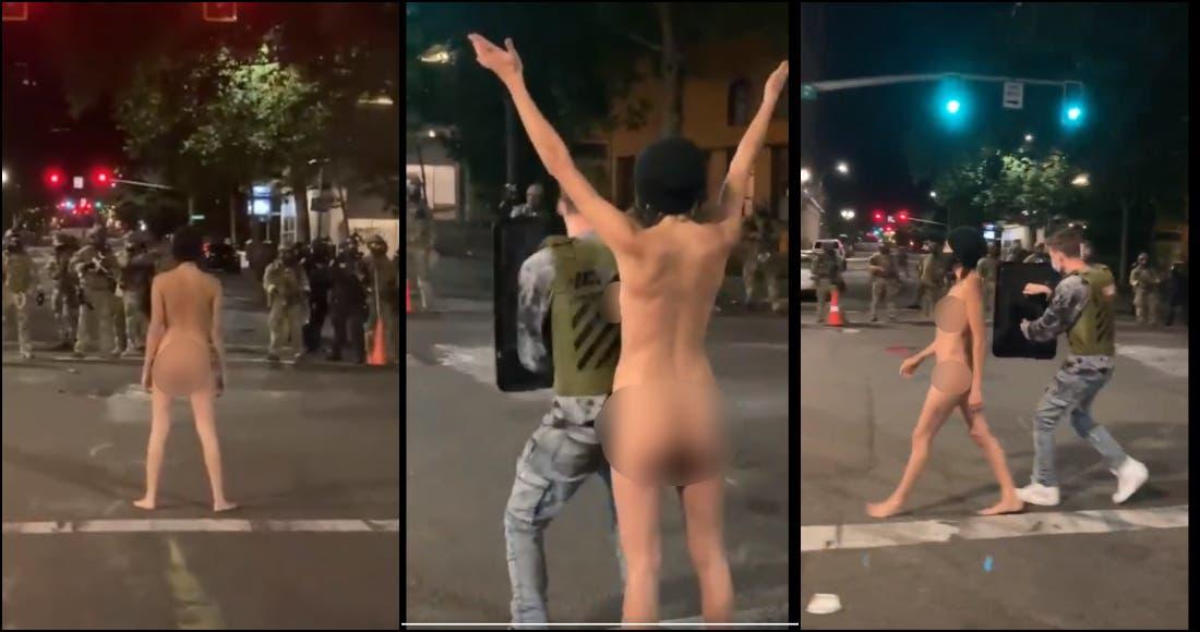 Mujer desnuda enfrentando policía durante protesta se hace viral
