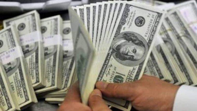 Autoridades allanan villa en Juan Dolio y ocupan RD$355 mil y nueve mil dólares